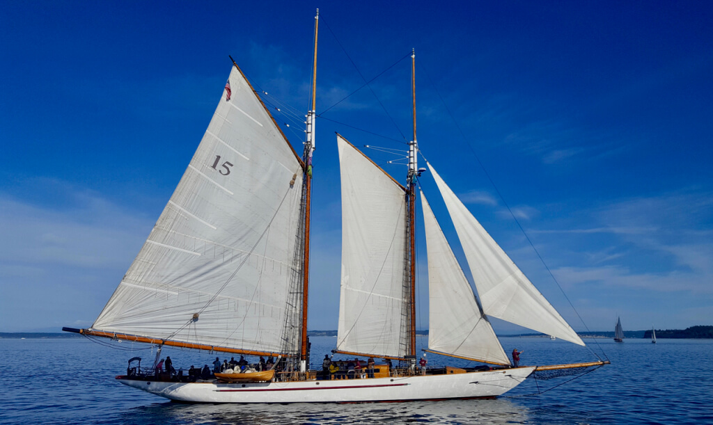 "The historic sailing vessel ""S/V Adventuress"" with full sails raised during the Sunday Sail-By."